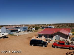 Over 2500 sq. ft. commercial grade shop with lovely mobile home on 20+ totally flat, usable acres.