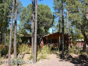Ponderosa pine, oak and Junipers cover this .48 acre lot