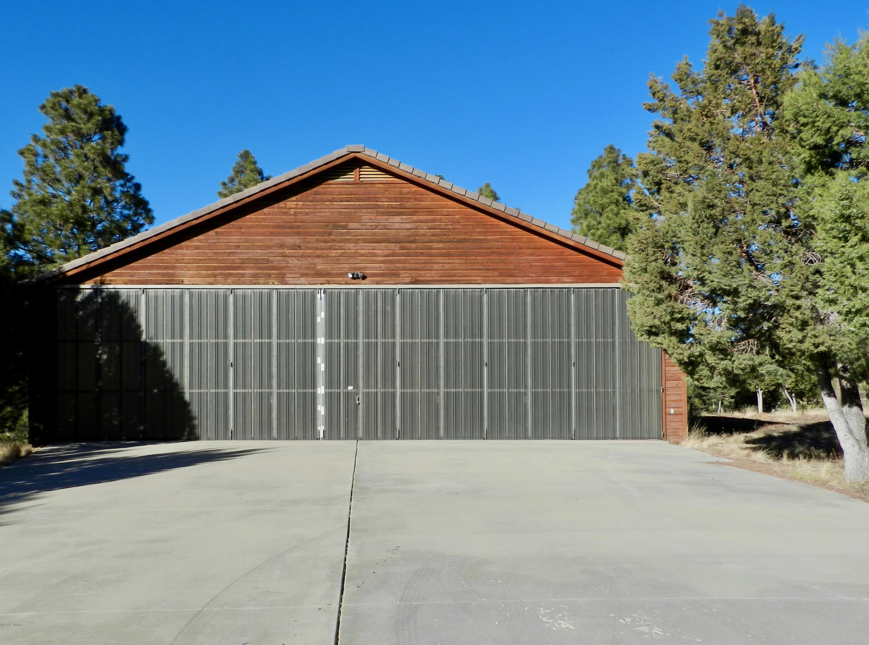 Pilots, build your mountain cabin retreat next to the existing 50' x 42' hangar with a 3/4 bath at the prestigious Mogollon Airpark (AZ82). Opaque stacking hanger doors provide plenty of natural light.  This heavily treed 0.42 acre VIEW lot has direct taxiway access. Utilities including electric, water and phone/DSL are available on the property. Need more room to build your dream home?  Adjacent corner parcel 206-29-110 is available.  Combine both properties to provide a 0.89 acre private home/hangar lot.  Local builder recommendations available. At 6,658 MSL it is the perfect fly-in escape from the summer heat or enjoy all 4 seasons. We look forward to seeing you at the Mogollon Air Park, Arizona's finest and friendliest residential aviation destination.