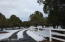 Beautiful white fencing along the length of the drive