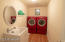 Laundry room with sink on same floor as bedrooms