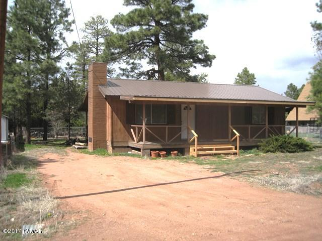 Great little starter house or summer cabin offering 2BR/1Ba, with gorgious stone fireplace with pellet stove conversion. There is laminate flooring in kitchen/dining area, and a utility room complete with washer and dryer. Neat and clean with appliances included.  Enjoy those warm summer breezes from the covered front and back decks.  County maintained access and priced to sell.