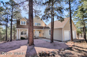 Beautiful home tucked in TALL pines!