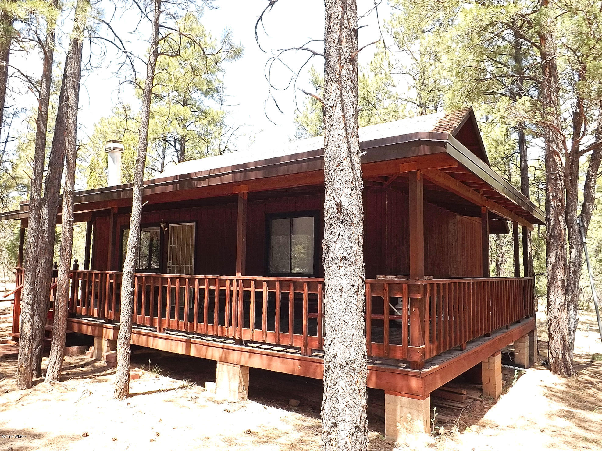 Stunning 3 BR/ 1.5 BA cabin in Overgaard AZ. If privacy, seclusion, lots of pines and wildlife is what you desire then here it is. This cabin is nestled on 3.10 acres of heavily forested land. This cabin features a great room design, with a stone faced fireplace, ceiling fans, a cozy kitchen, nice sized bedrooms. a loft area, knotty pine T&G ceilings,  beautiful wood finishes throughout, baseboard heating, carpet and laminate flooring and exposed wood beams. The exterior offers a full length covered front deck and a utility building. This is a must see.