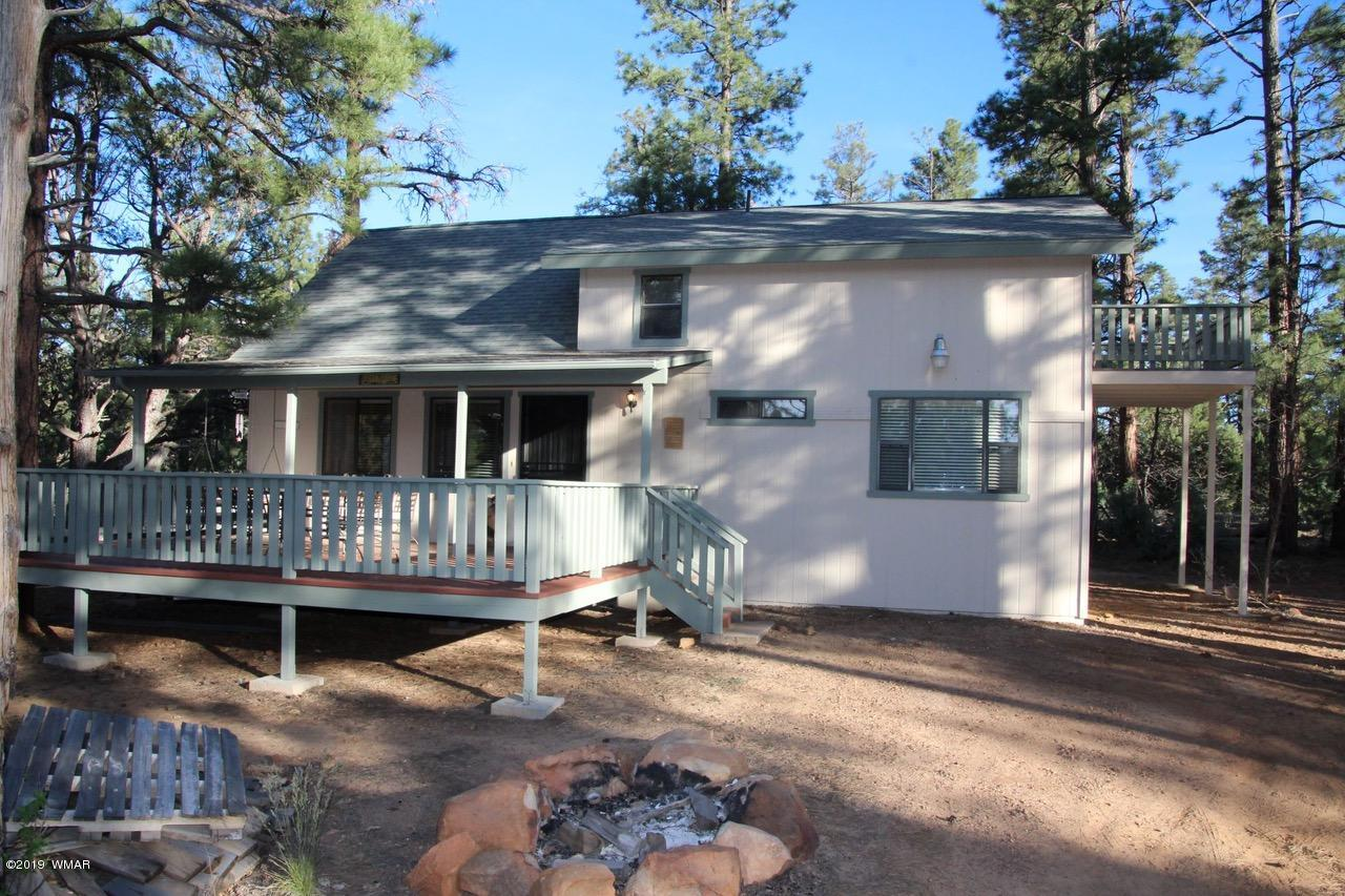 Secluded cabin tucked away on 2.5 acres of tall pines. Huge 3 car detached garage to house all your toys  Huge front deck (built around a tree) with porch swing to enjoy mother nature. Appraisal in hand that backs up price....this cabin is a must see, won't last.