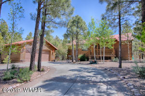 Nestled in the cool, tall pines of the gated Bison Ridge community.