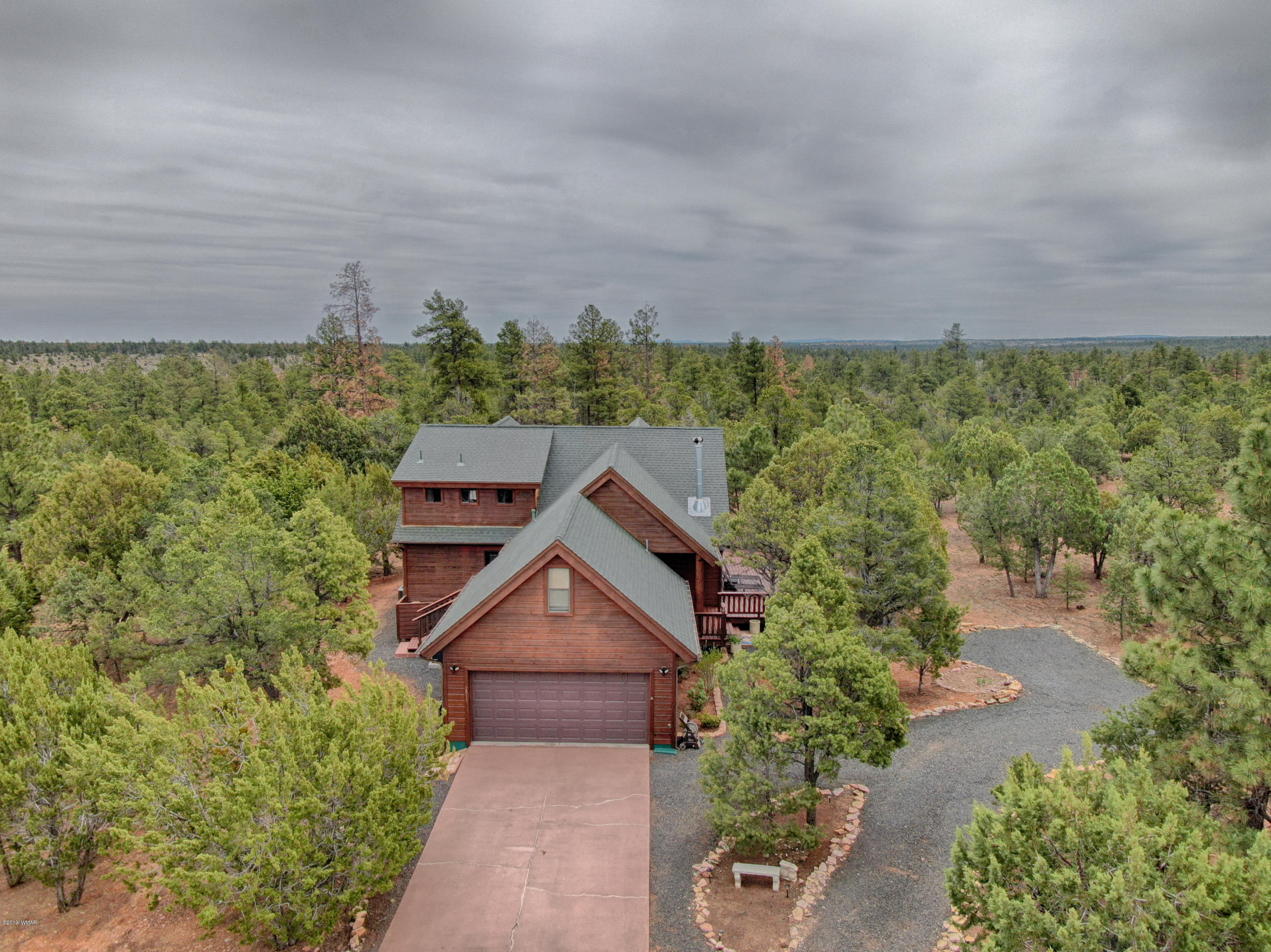Enjoy the peaceful setting on the enormous wrap around deck that backs up directly to the National Forest. This home is located in the prestigious Mogollon Estates surrounded by tall Ponderosa Pines. Other features include vaulted ceilings, open floor plan, loft area, new AC/Furnace, solid hickory flooring, backup generator, wood stove, fresh stain on the exterior, newly remodeled bathroom, Quartz countertop, two master bedroom plan, slate tile, two car garage, paved streets, and a second floor balcony that overlooks the back yard and into the National Forest. Click on the virtual tour link to take a tour of the home!