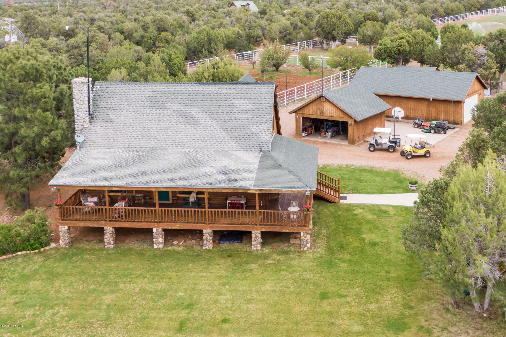 25 Acre Ranch in the middle of the Sitgreaves National Forest. Completely fenced, this secluded property has it all. Enjoy beautiful views of the lawn, green pastures, and natural foliage while relaxing on the covered deck of this 4 BD 3BA log home. The 3000+ sq ft barn has oversized stalls, a wash bay, tack room, office with sleeping quarters, automatic waterers. The drive through barn has a side door making loading and unloading easy and convenient. This unique property is a must see.