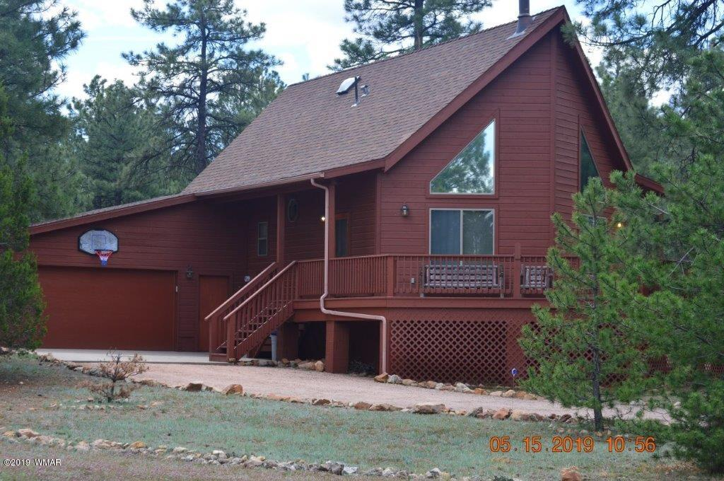 This is the one!  This Chalet style cabin in the the pines is an exceptional property.  VERY well kept with 3 bedrooms, 2 baths real wood floors, great room, UV window tinting and privacy in one of the best locations in the area.  2 car garage for the cars or toys!  Extra room under the house for root cellar hobby room or just  safe dry storage.  Newer AC/Heating and Hot Water Heater.  Must see to appreciate.