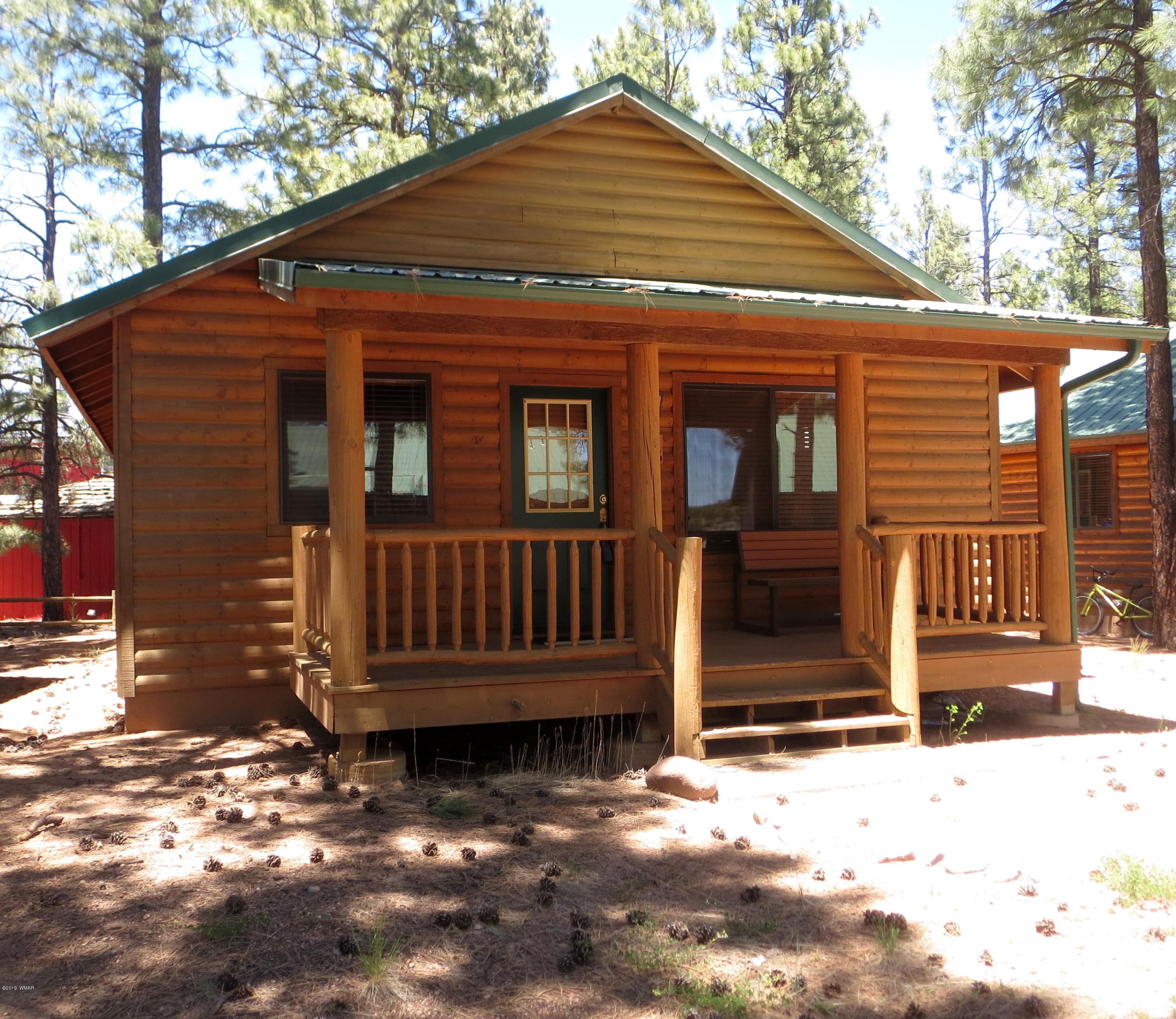 A cozy, fully furnished cabin in a quiet and peaceful area of Bison Ranch.  This cabin has been updated with painting, new carpet and beautiful granite counter tops and new sinks throughout.  A short walk to the park, fish & release pond, tennis courts and playground area provide fun for the whole family. Close to the National Forest for miles of hiking, riding quads or driving thru the forest and spotting all the wild horses, deer and elk. Nearby amenities include the Bison Town restaurant, shops and horse back riding stables. Plenty to do or just relax  and enjoy the area.