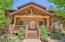 Gorgeous entry with hand carved door and custom log accents