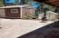 Backyard shed, chiminea, green house