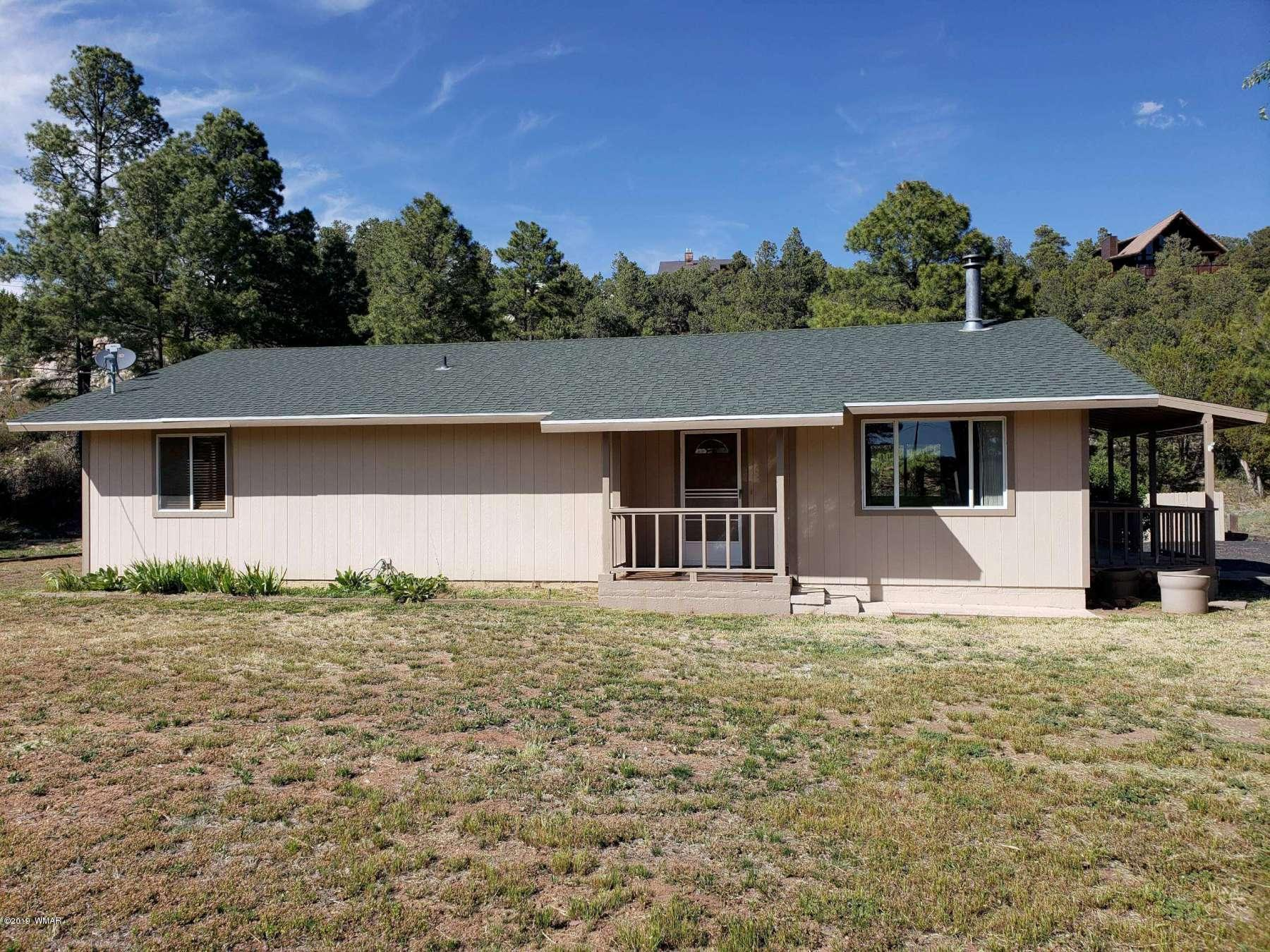 Beautifully Remodeled Single-level Year-round or Summer Retreat in a Beautiful Setting in Overgaard, Arizona.  This 2 Bedroom, 2 Bath Home has a Great-for-Entertaining Floor Plan and on Two Lots (APN 206-28-050).  This Home has recently been Painted Inside and Out, has New Flooring and New Tiled Bathrooms and Beautiful Decks to Enjoy the Beautiful Outdoors.  There is a Detached Garage and Extensions to Sit and Enjoy More of the Outdoors.