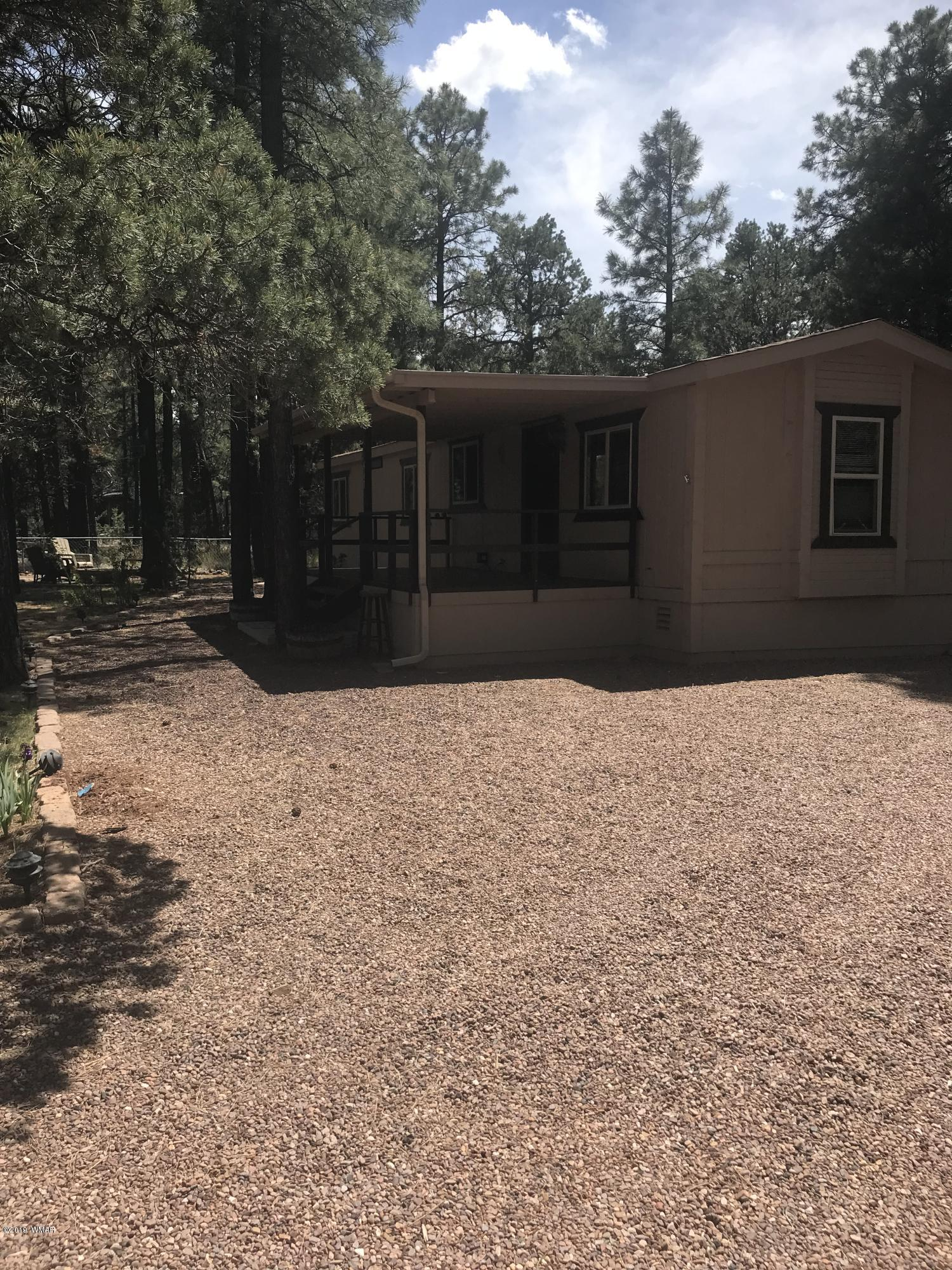 Nice 2 bedroom 1 bath mobile in the heart of Overgaard nestled in the tall pines.  Priced to sell.