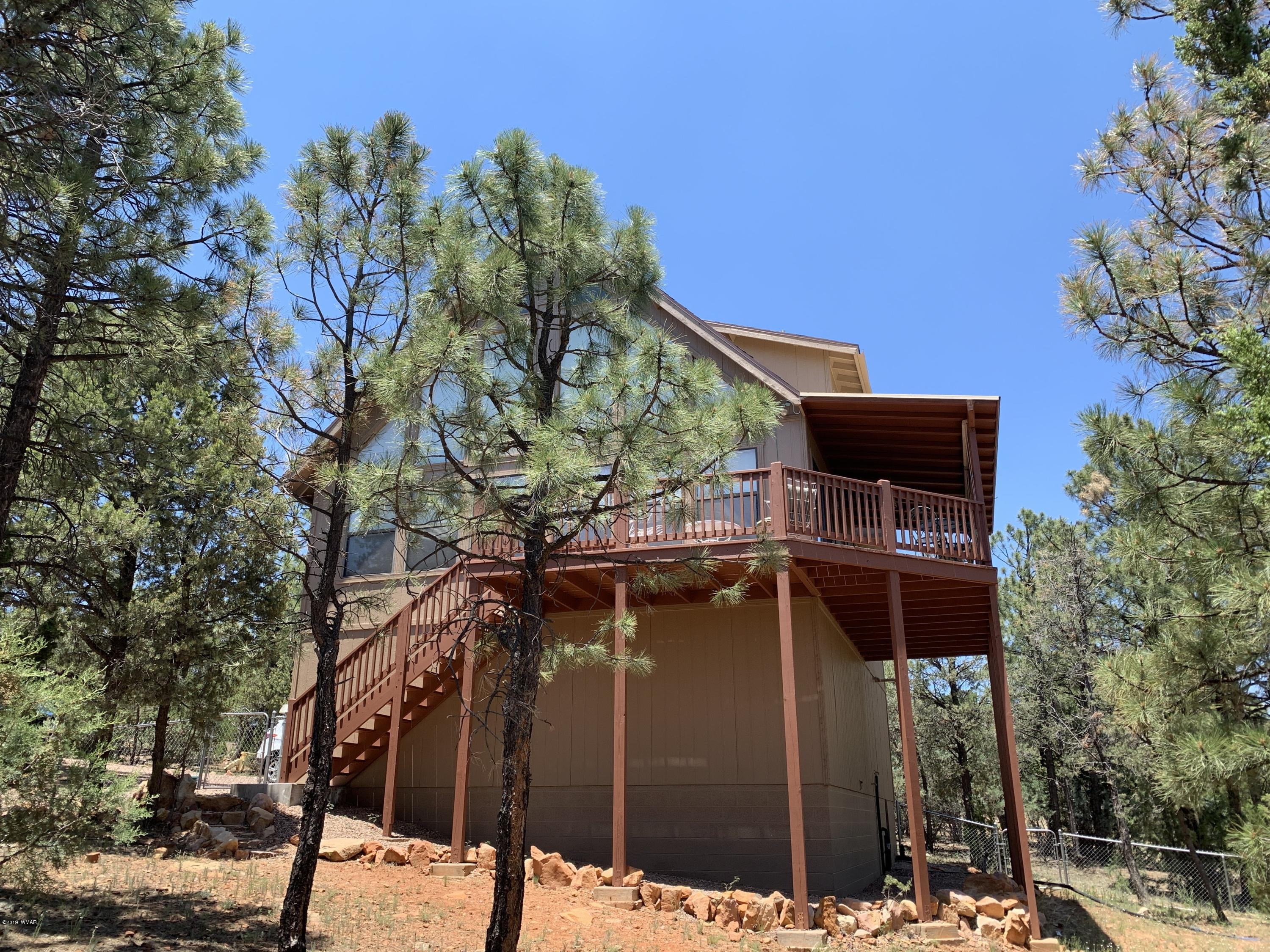 This is the home you have been looking for. You feel perched on top of the world.   The 2 story vaulted ceiling has the wall of windows to enjoy the endless panoramic ponderosa pine views. Open the door to the open floor plan feel. Cozy kitchen w/ breakfast bar & dining area. The living room has the WALL of WINDOWS bringing the outdoors in. Main floor features 2 bedrooms w/ full bath.  The master retreat offers a loft which is perfect for a relaxing space or office.  The master is large w/ a walk in closet & en suite bathroom w/ jetted tub & bidet.Lower level is the entrance of garage and provides the laundry area w/ workshop & storage. Bonus area is ready for your final touches to offer even further rooms for entertainment.  Decks & fenced yard for outdoor enjoyment. So much to ment