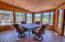 Comfortable screened in porch with fantastic views, and tongue and groove ceilings