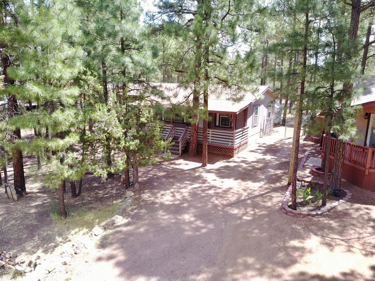 You will fall in love with this spacious manufactured home that has been well-maintained andhas lots of towering ponderosa pines on the property; offers a 3BDR/2BA split floor planwith a separate laundry room and open living area, large covered deck to sit out andentertain in the beautiful rim country. This home would be the perfect summer get away or a fine place to call home year round.