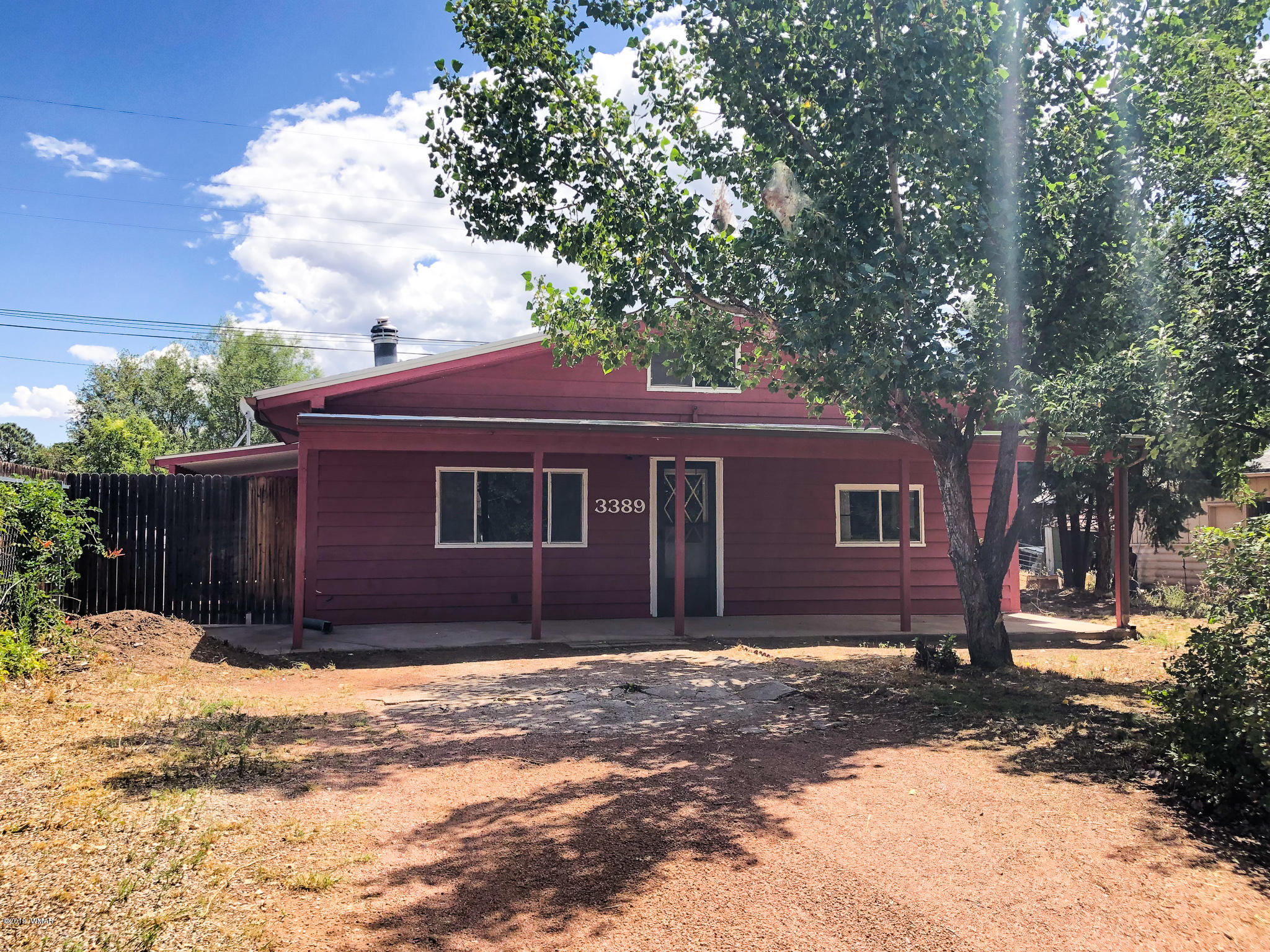 Looking to escape the heat? Look no further. This 2 bedroom, 1 bath home offers new interior paint and kitchen flooring. Enjoy the established trees, rear property privacy fencing and front covered patio. Bring the toys, No HOA. Full-time or part-time use. Close to forest service trails and local services. Make this property yours today!