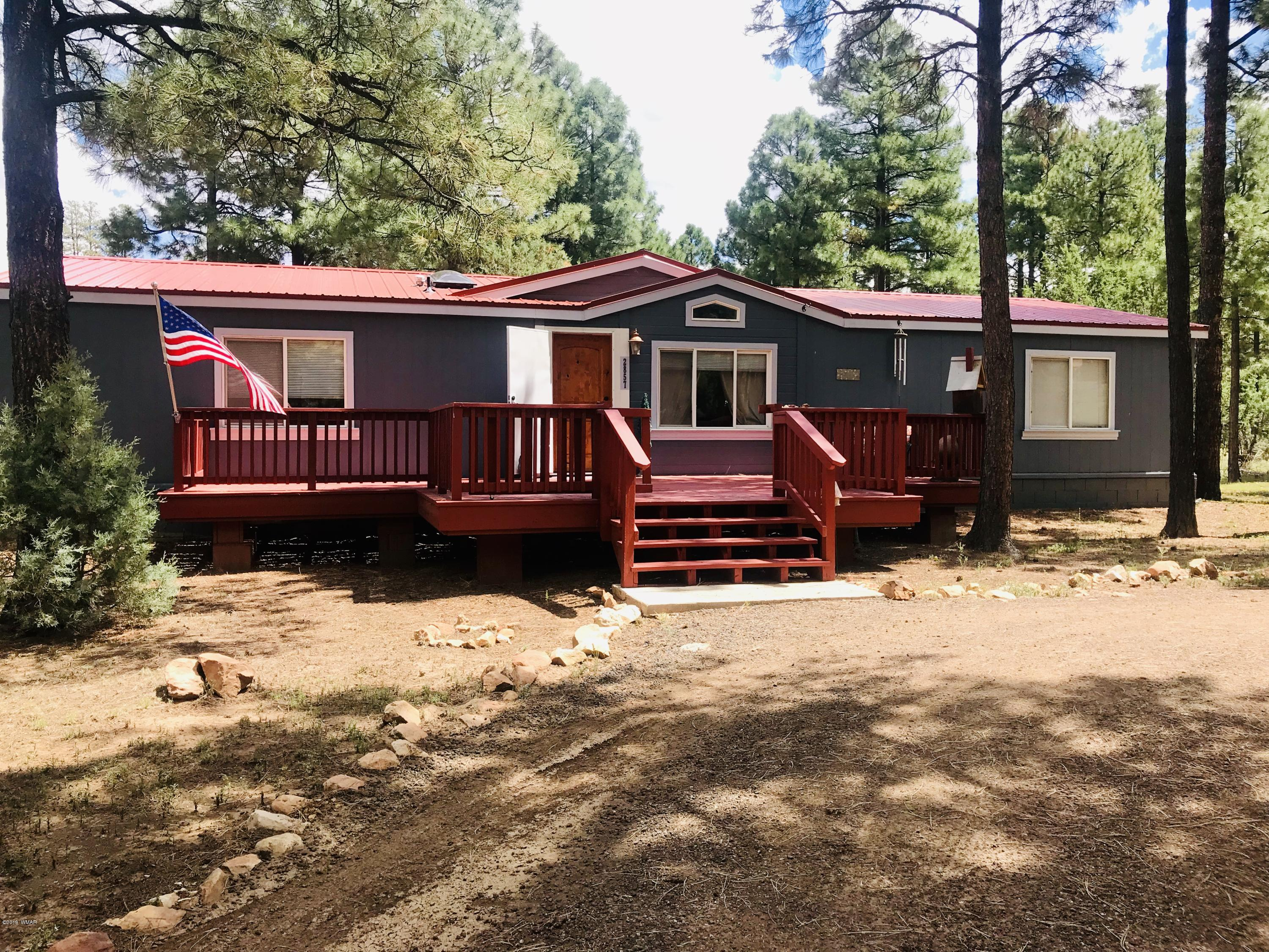 Do you like to take your horses or toys out to ride in the forest? Then this property is for you!! It is right on the edge of the National Forest and located in the tall pines!! This highly upgraded split floor plan manufactured home is nestled amongst tall pines on a private dead end road. Open floor plan with a large great room and dining room. The oversized kitchen features granite, ss appliances and a butcher block island. Granite and custom sinks in both baths.