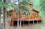 The 5 bedroom cabin on the East side of the River and backs to the Forest Service