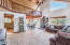 Open floor plan with tongue & groove vaulted ceilings, huge loft area, and dining space.