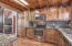 Kitchen complete with stainless steel appliances, granite counters, and upgraded cabinetry.