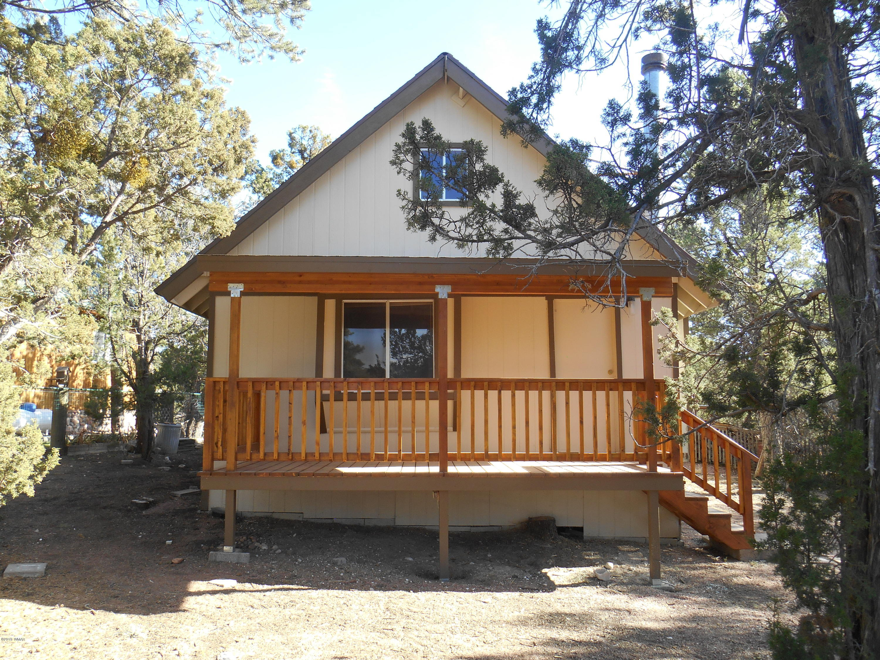 This adorable recently remodeled and updated cabin has 640 sq ft on the main level and approximately another 216 sq ft in the loft. 2 beds and the bath downand plenty of space for overflow in the loft. The interior features new kitchen cabinets, counter-tops, flooring throughout, bathroom sink, toilet, re stained ceilings. The exterior has been freshly painted and a new covered deck. County maintained roads leading you to the quiet pace of the White Mountain life here on 3335 Little Pine Dr. Ready for you to light up that fireplace and sip on some hot cocoa. Ready - Set - Move In!