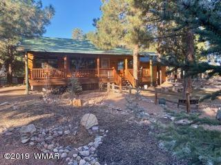 You will want to see this cozy little 2 bedroom, 2 bath cabin situated on almost 1/3 of an acre with a garage and a 10X10 shed.  Perfect for the weekend getaway or full-time living.  Nestled in the community of Bison Ranch  with catch & release fishing, children's play area, tennis court, volleyball and basketball.  A must see!