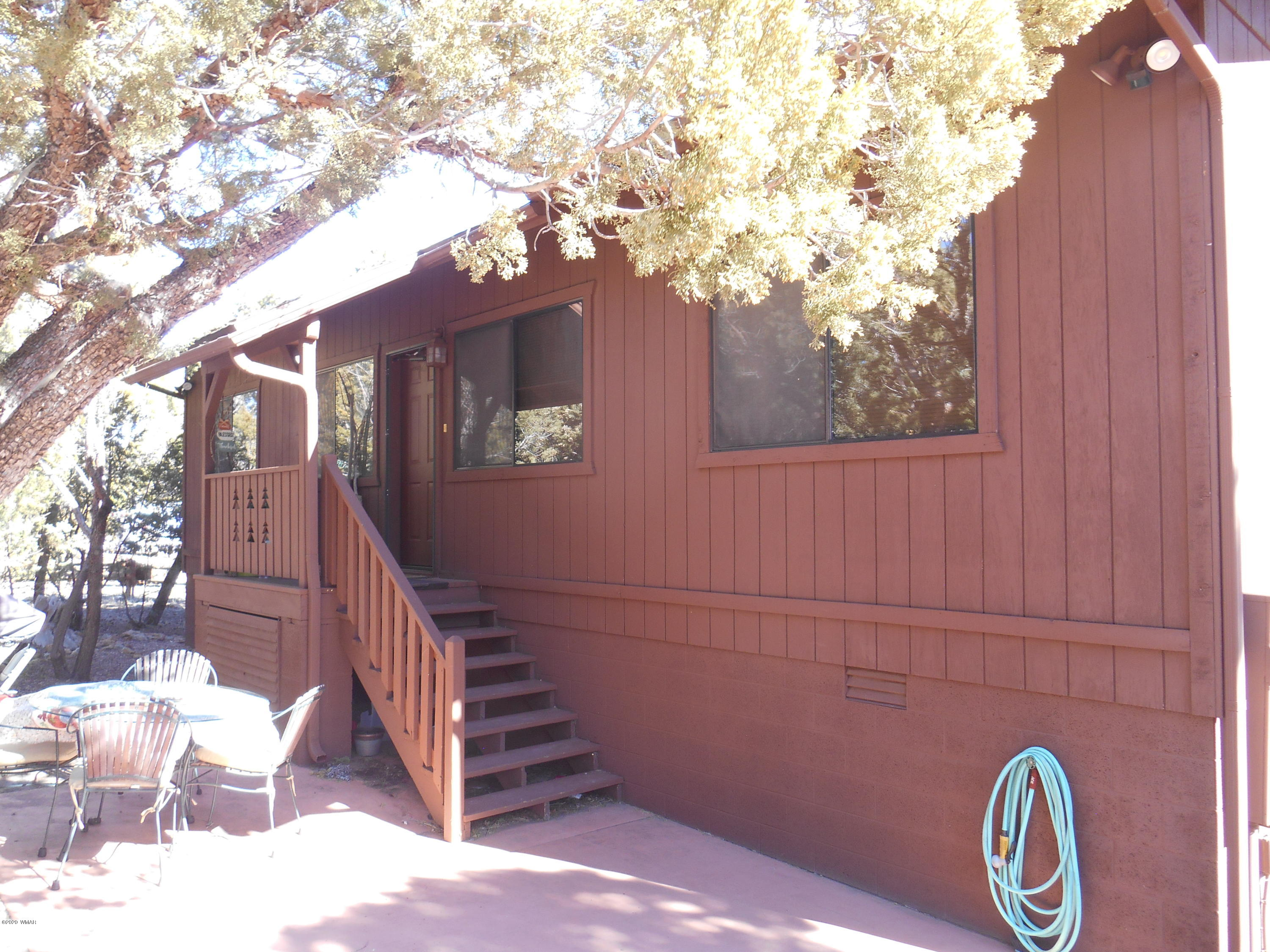 2BR/2BA cabin in High Country Pines.   Woodstove for those chilly days.   Pergo Flooring through except for carpet in the bedrooms.   Spacious basement for storage.Screened in covered back deck to enjoy the gorgeous views.  A must see.Gas cooktop in kitchen.Furniture Available outside of escrow