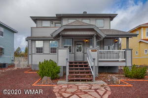 Craftsman style home with large covered deck