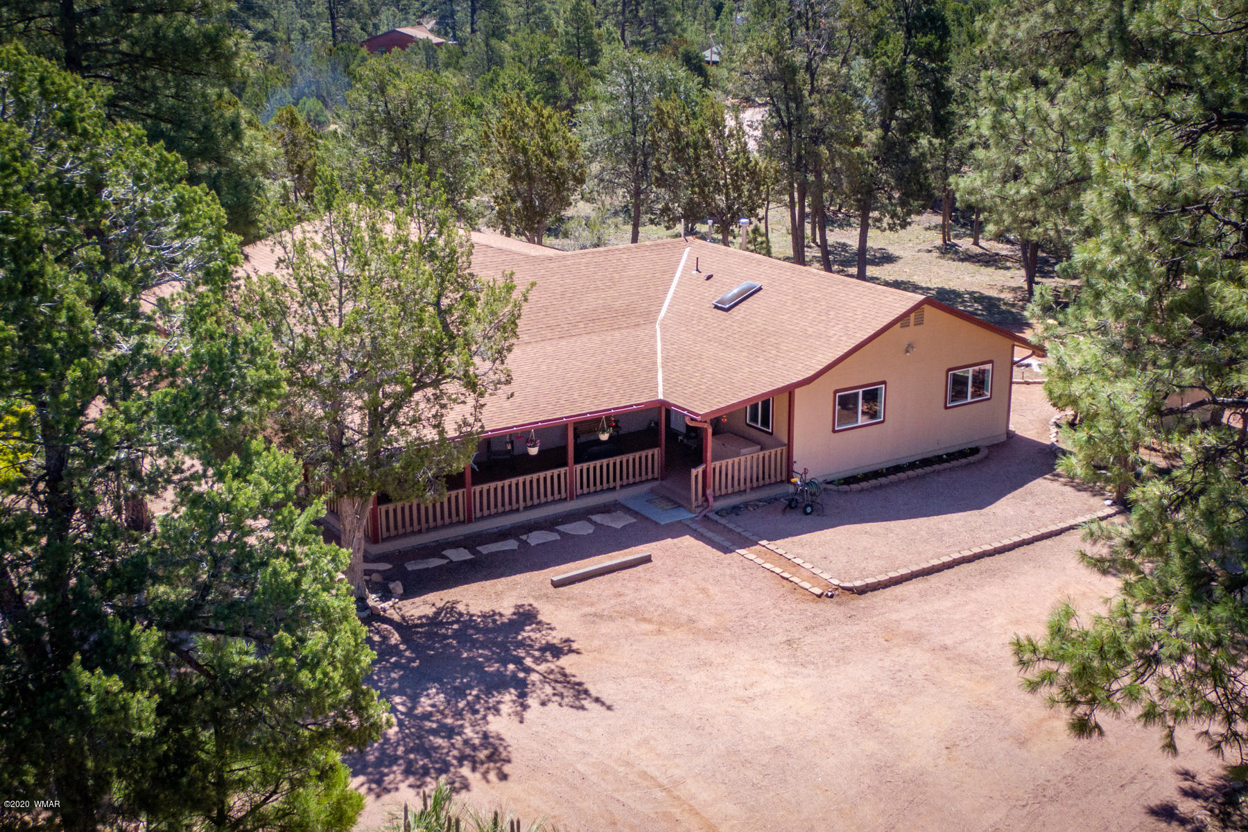 Seclusion in the Towering Tall Pines! This ranch style single level home has a split floor plan w/ 3 bdrm, 2 bath plus expansive office or exercise room and an add'l hobby/workroom. Interior boasts beautiful new engineered laminate floors, upgraded kitchen cabinets, new lighting as well as a formal dining room and wood-burning stove. Outside offers a large covered composite deck overlooking 2.75 acres of heavily treed property ideal for gathering w/ family and friends or watching the kids and animals to run and play. The property also comes with an over-sized two-car garage, 20x30 carport, RV dump & hookup, utility sheds, raised garden, chain link cross fencing and so much more. All this conveniently located in the heart of Heber-Overgaard, only minutes away from Nat'l Forest. Call TODAY!