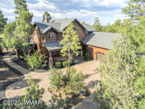 Beautiful Torreon home tucked away in the trees on the Golf Course!
