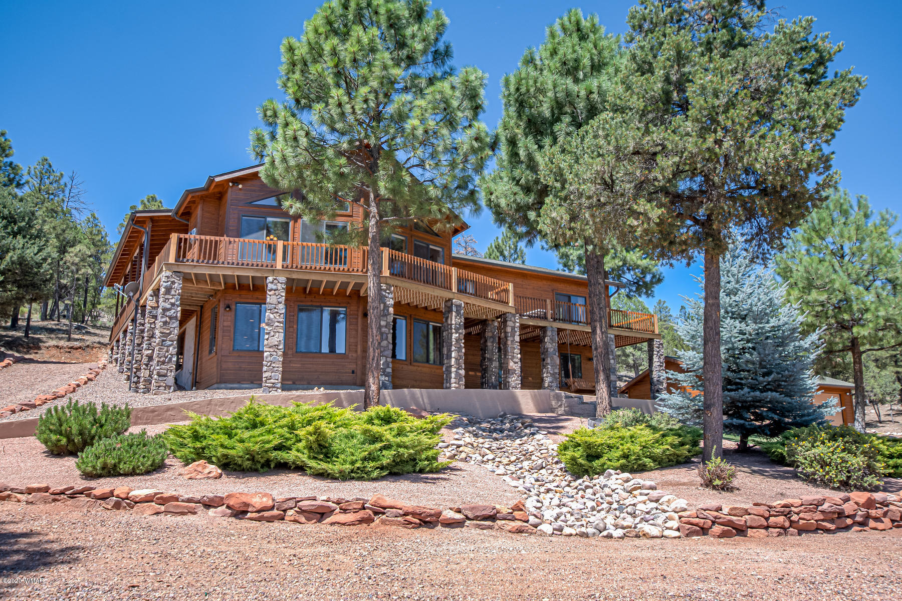 This home in Heber has it all!  Situated on just over 3.5 acres, you will experience privacy and uninterrupted views. Indoors, bright natural light and open spaces will have you feeling at home. Large windows in the great room provide excellent views of the surrounding forest.  Warm winter nights by the fireplace await. The kitchen is well equipped for preparing your favorite meals. The large center island provides excellent prep space as well as an eating area. A walk-in pantry showcases the entirety of your ingredients. The dining space off the kitchen allows for a more formal setting. Wind down at the end of the day in the private master suite. Embrace the outdoors at your leisure with direct deck access. A stacked washer and dryer in the master closet adds practicality. Dual vanities in the master bathroom will make your mornings a breeze! Six additional choices of bedroom make this home an excellent choice for families and hosting guests. Make memories playing games and watching movies in the lower level family room. Kick off your boots and get muddy clothes straight into the laundry in the lower level mudroom. Wrap around decks provide every opportunity to witness the breathtaking views. Your tools, toys, and vehicles will be safe from the elements in the detached three car garage. Gather around the firepit to roast marshmallows! The grounds directly surrounding the home are beautifully manicured, while the forest land encourages exploration. Keep in shape in a thrilling way by rappelling on the stunning rock outcropping featured on the property. This incredible Heber home offers an opportunity to live a luxurious and exciting mountain lifestyle. Don't let this chance pass you by, schedule to see today!