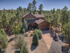 Towering Ponderosa Pines, beautiful Oak trees, River rock french drains, and surrounding forest give this home a peaceful natural setting.
