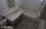 Tub/Shower and storage cabinet on the wall plus extra storage under the sink.