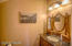 Lower level half bath/powder room.