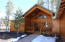 Full wood sided home in the tall pines