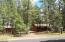 Just under an acre, .92 of an acre of beautiful tall Pines.
