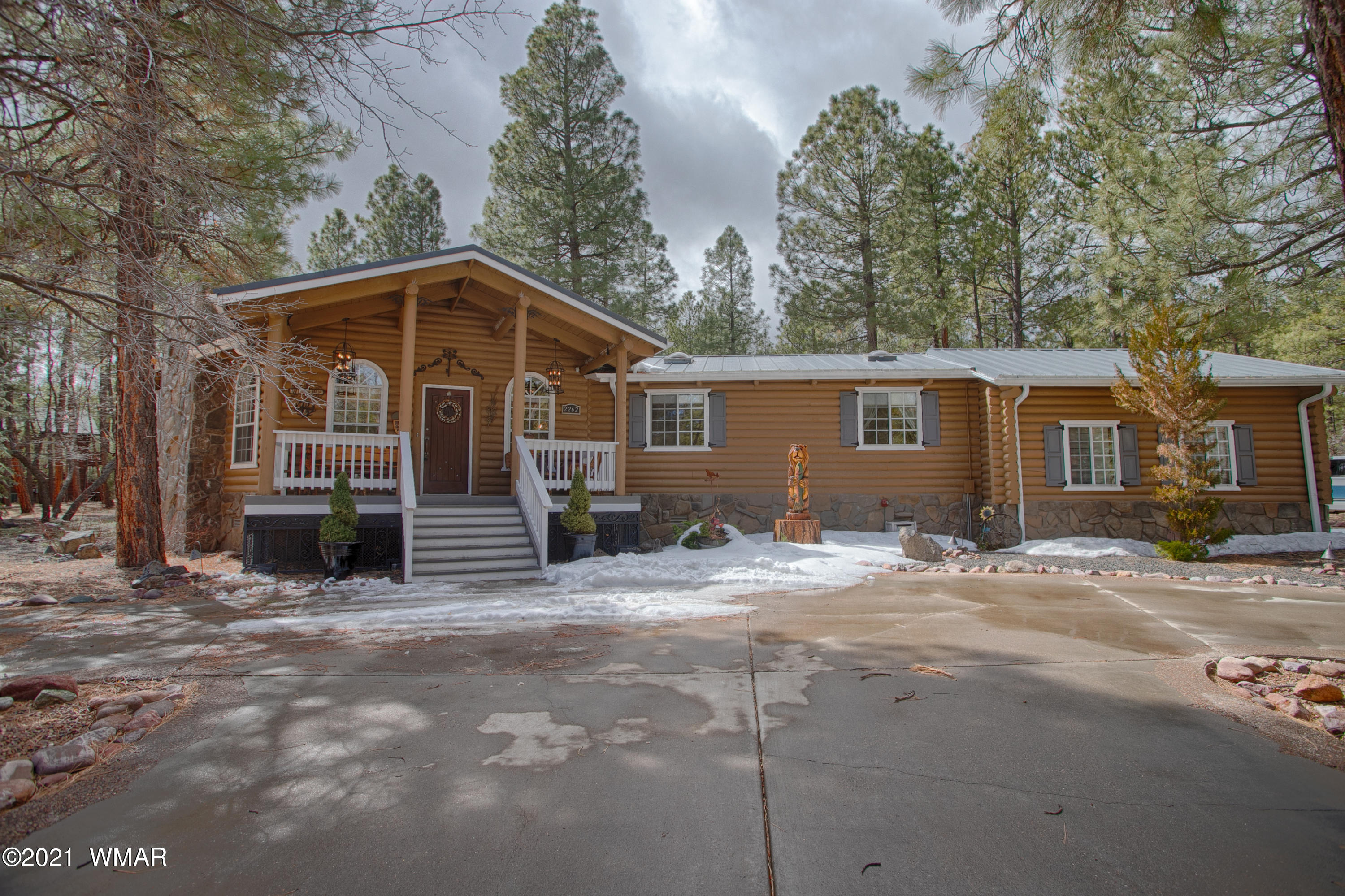 Incredible log home in Pinetop, AZ.  Unique octogan living room with vaulted ceilings and open kitchen with two separate wings. One wing houses the  master suite and game room and the other wing has two bedrooms, bath, and laundry, leading to 2-car garage.  Gorgeously decorated, this home is being sold furnished.  Home is on 2.5 acres and has a private well.  Covered front and back decks. Back yard area is partially fenced.  Outdoor spa is next to a small stone building (500 sf) that has heat and electricity to it.  This could be a workshop or whatever you want it to be.  It also houses the well equipment.   No HOA.   One of the sellers is licensed to sell real estate in Arizona.