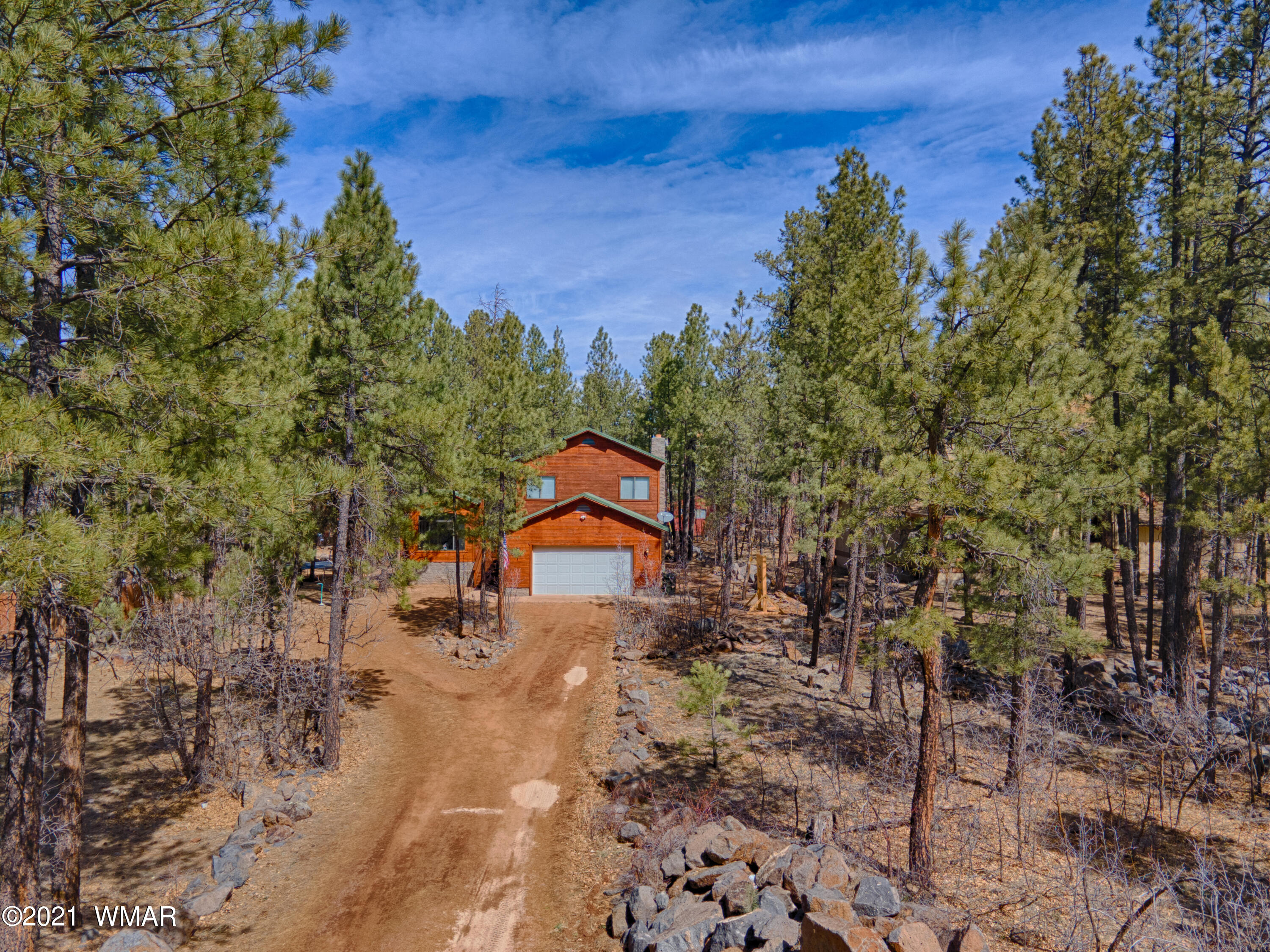 Great horse property in Pinetop Lakes Country Club. Three level home with a living room and  family room and a finished, heated basement which would make a great media or exercise room. Other room is a finished basement heated  but is not included in the square footage.