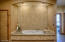 Heated Floors, Therapeutic tub, sound system in bathroom