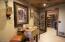 Entrance to Wine Cellar with custom wine tasting table & stools