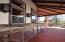 Outdoor Kitchen equipped with custom smoker, dishwasher, sink & sound system