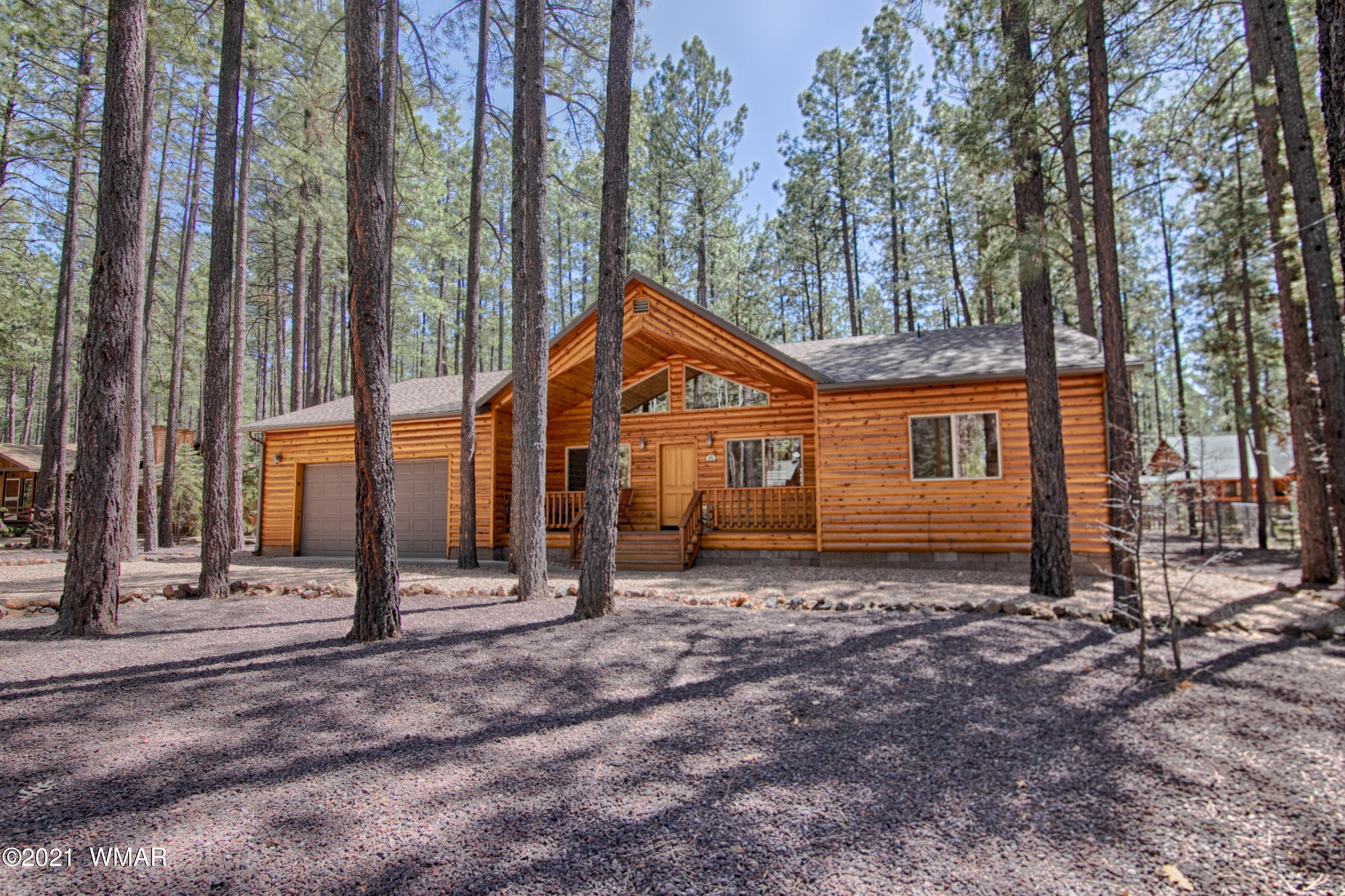 Pride of ownership throughout  in this home located in Pinetop Country Club!  This log sided home nestled amongst tall ponderosa pines is in  immaculate condition. The perfect cabin in the woods! Vaulted wood ceilings, hardwood oak flooring, hickory cabinets,  corian countertops, solid wood doors, stone fireplace with gas starter, split bedroom floorplan, large covered deck in the back to enjoy the cool mountain air are just a few of the many amenites this home has to offer. An inventory  list of furnishings that stay will be provided. There are 5 large area rugs available to purchase  outside of escrow. Use showing time to make appointment. Sellers are sometimes up,  so an appoinment my be required at times. Virtual tour to come.