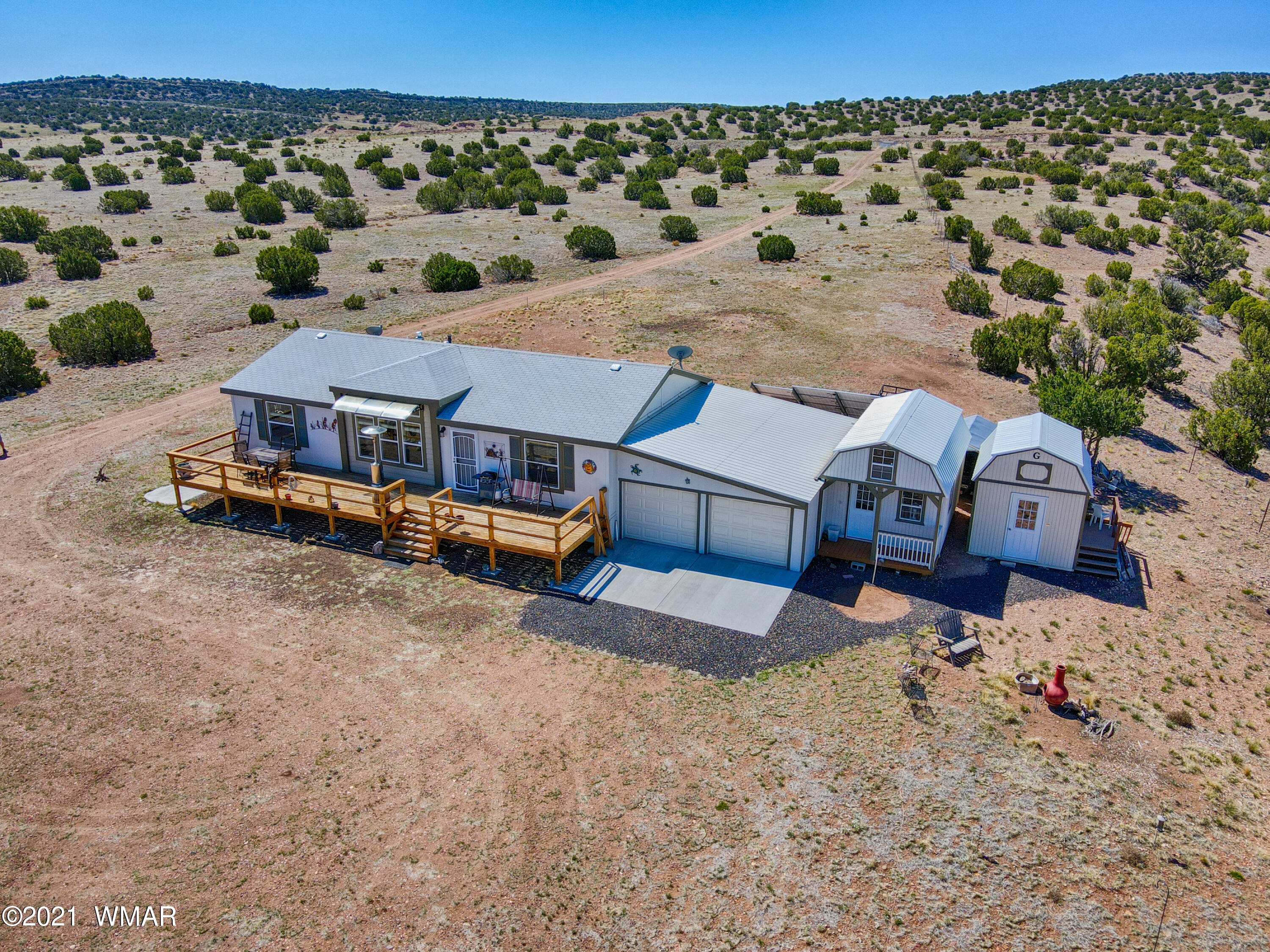 Peace, tranquility and wide open spaces are just a few ways to describe this lovely home that sits on 120.22 acres!! This home is completely off the grid with a 4.1kw solar system, septic system, 550 gallon & 1350 gallon holding water tanks and propane; all installed in 2018. This CAVCO home was manufactured and installed onto the property in the year 2018  with an added on two car garage, added game room and (not added) shed that is now considered a ''she shack'' with a built on porch.  With every window comes breathtaking panoramic views of rolling slopes, at night you can enjoy the most serene night sky and during the day enjoy the piece and quiet that the property has to offer.  This home will not last long, call today to schedule an appointment!