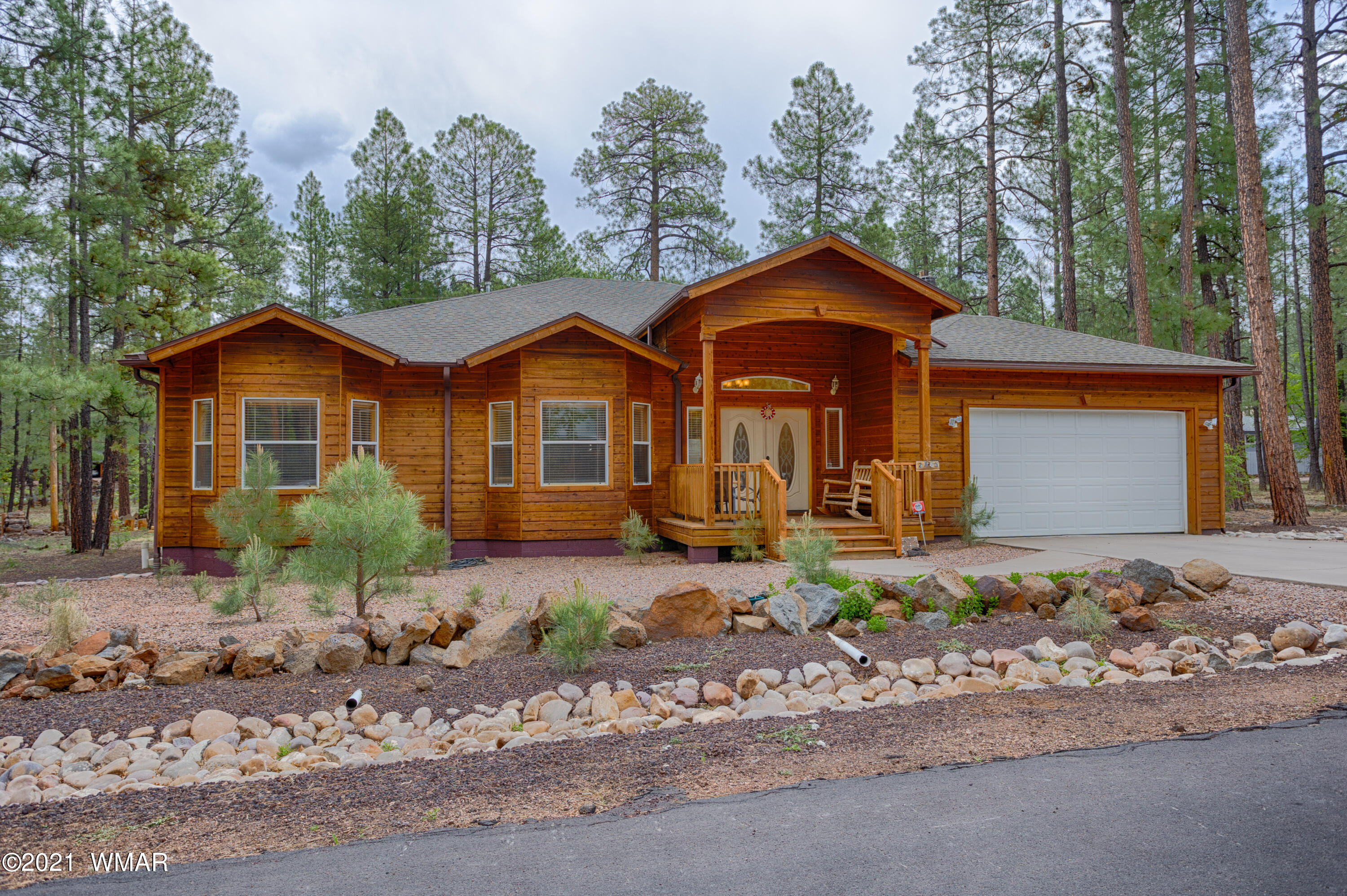 BiG PRICE REDUCTION  of $77,000 until end of day Sunday August 1st.  Cedar sided home in Pinetop Lakes. 4 bedroom, 3 bath in a prime location. Great room with vaulted ceilings and a river rock fireplace. Breakfast bar, eat in kitchen and a formal dining room makes for excellent entertaining! Custom maple cabinetry throughout. Wonderful decks to enjoy the cool mountain air. This home has recreation center privledge, part of the HOA fee of $335 per year  Close to National Forest and many trails. Home is occupied but  can be easily shown.