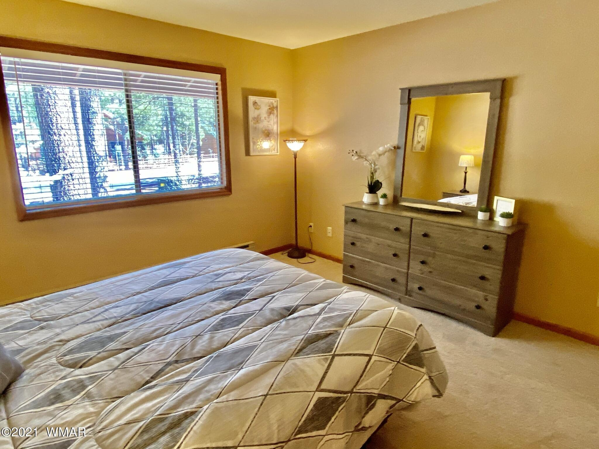 This home is show room ready! Most everything in this condominium is NEW. ''Pride of ownership''. Excellent property for a vacation rental, completely turn key. Walk to dining and golfing and just a short drive to fishing and skiing.