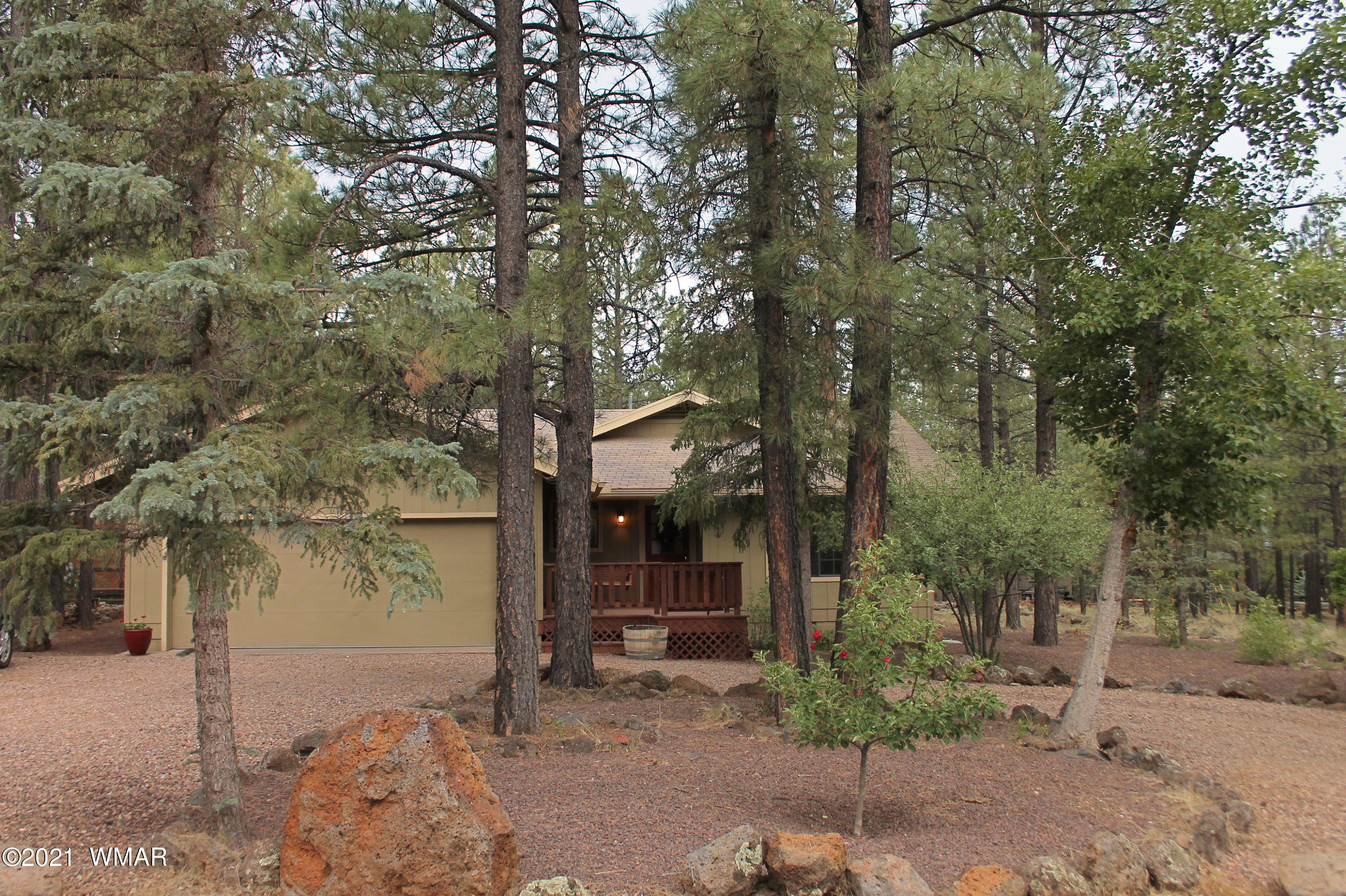 3 bedroom, 2 bath, 2 car attached garage, single story home in Pinetop Lakes. Rec center privileges. Comes with a large covered back deck, tall pines, heavily treed, landscaped,  lot is .32 of an acre. Sits on the lot to take advantage of the suns path so as to be cool during the summer. Super low traffic flow on the street, circular drive, fruit trees. Home has vaulted ceiling in living room and master bedroom.  Comes with a family room, furniture included with an acceptable offer. Place is in great shape and ready to move into. Property is close to National Forest. Take advantage of all the amenities available through the HOA. Close to all fishing, hiking, biking, hunting, camping as well as all the other activities The White Mountains are known for.