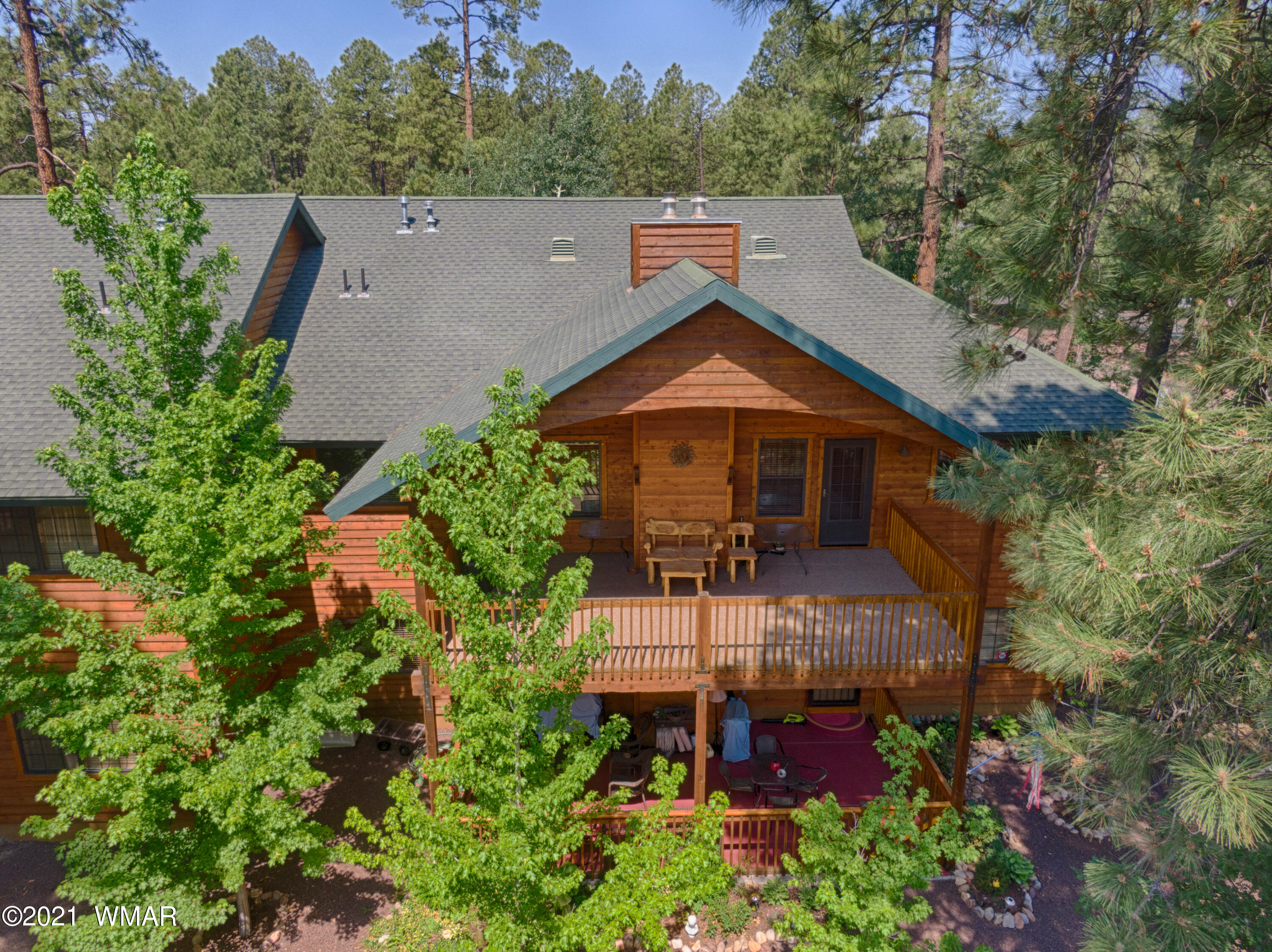 Beautiful upper unit in the gated community of High Country Village in Pinetop Country Club. This spacious and open concept floor-plan offers plenty of space for you and your guests! Featuring tile floors in the kitchen, hickory cabinets throughout, a large pantry and laundry room, vaulted ceilings in the main living area with cozy fireplace complete with a rock surround and juniper mantle!  Your time will be well spent, relaxing on the large, covered back deck enjoying the view and mountain air. Low maintenance and with a detached single car garage this is just what you need for a mountain get away. Close to National Forest access, golfing, trailheads, dining and so much more!  Being sold furnished and is move in ready!