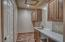 Laundry/Mud Room off Garage with Lengthy Folding Countertop